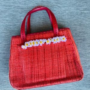 Cole Haan red straw bag with daisy chain detail